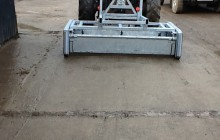 Yardscraper attached to tractor